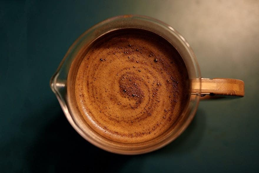 Overhead view of French press coffee brewing