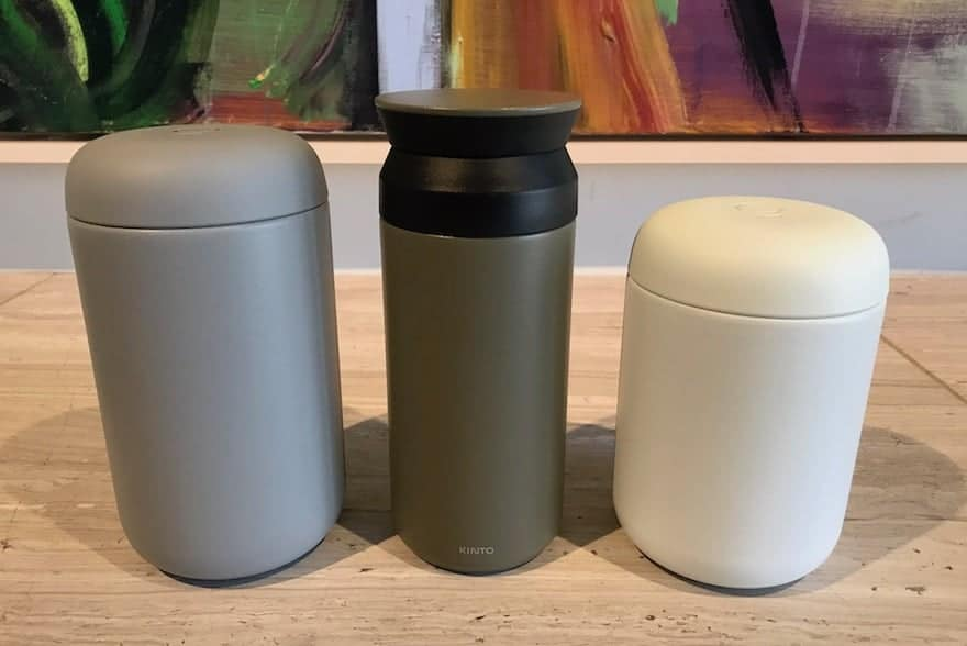 Kinto Travel Tumbler flanked by two Carter Everywhere Mugs