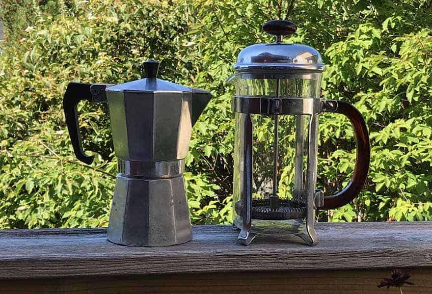 A moka pot and a French press side by side
