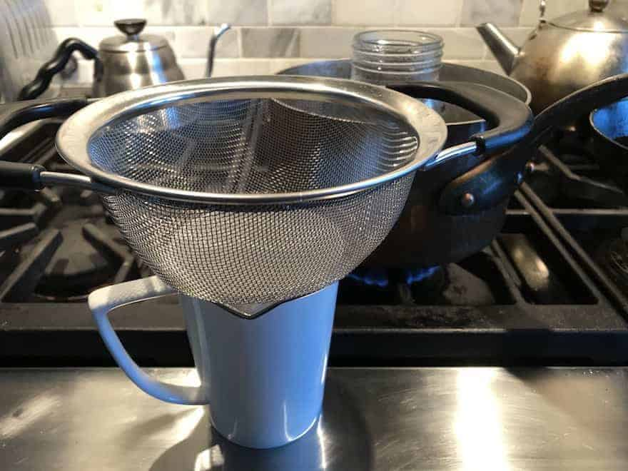 Strainer on top of a coffee mug