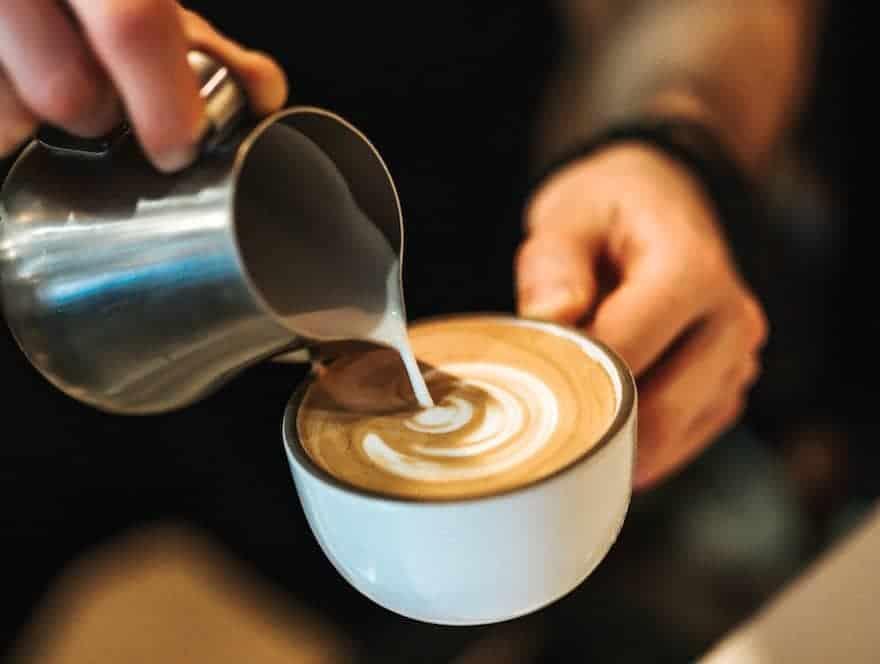 Pouring foamed milk for latte art