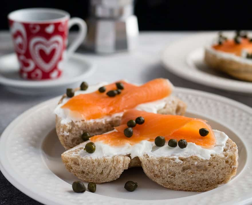 Bagel topped with cream cheese, smoked salmon and capers