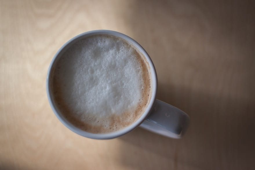 A cappuccino from above, with the milk froth clearly visible