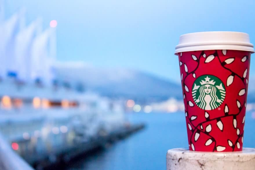 Starbucks coffee in a Christmas cup outside Canada Place in Vancouver
