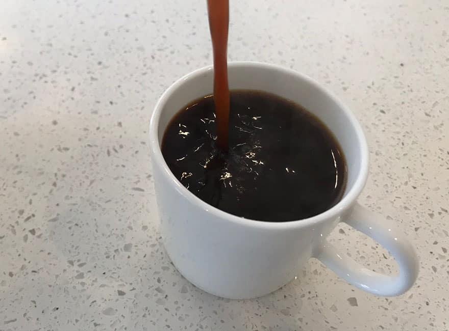 pouring moka pot coffee 0826
