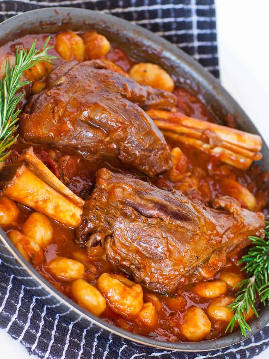 braised lamb shanks with red wine tomato sauce and gnocchi