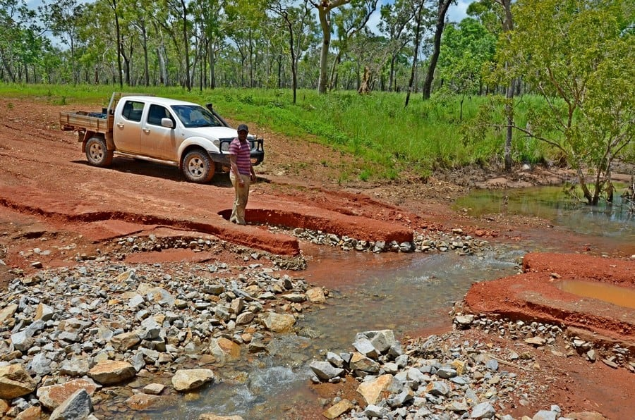 ute and man next to road washout