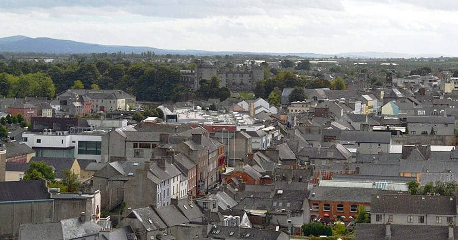 Looking over the city towards Kilkenny Castle from the top of the Round Tower. - The Irish Place
