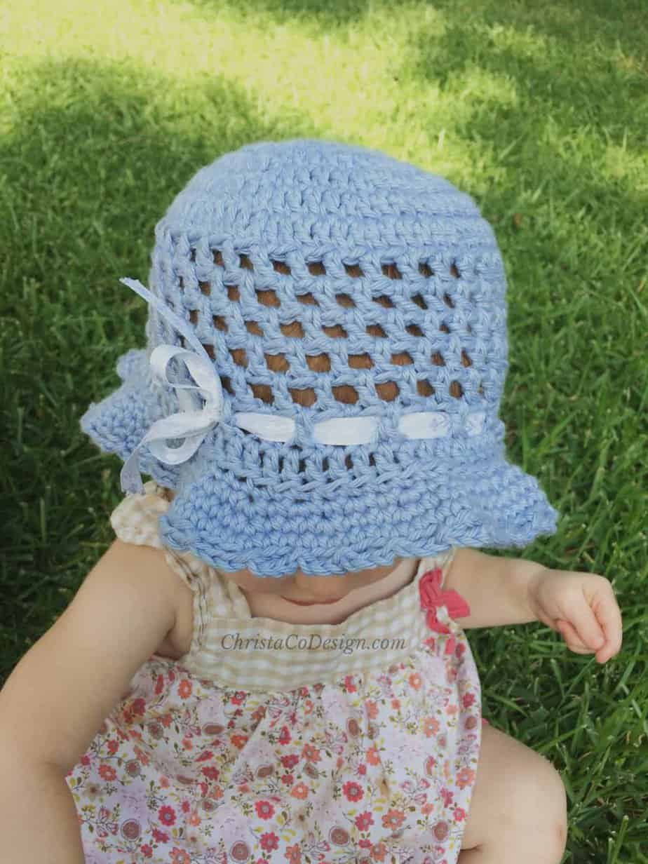picture of baby outside in toddler sun hat