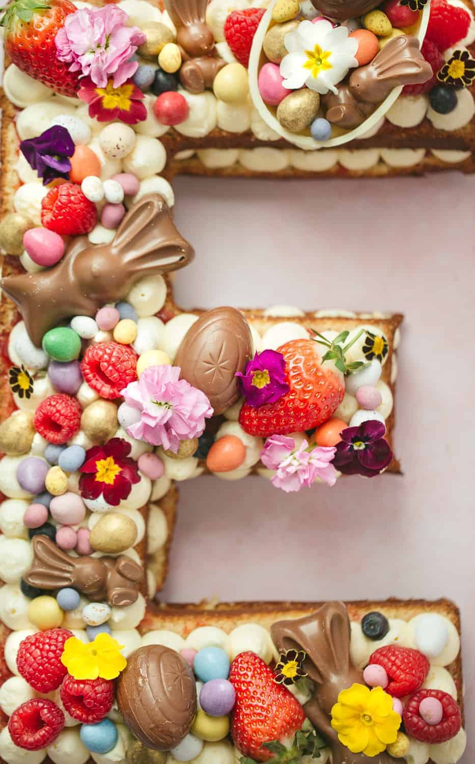 Letter cake in the shape of an E topped with Easter chocolate