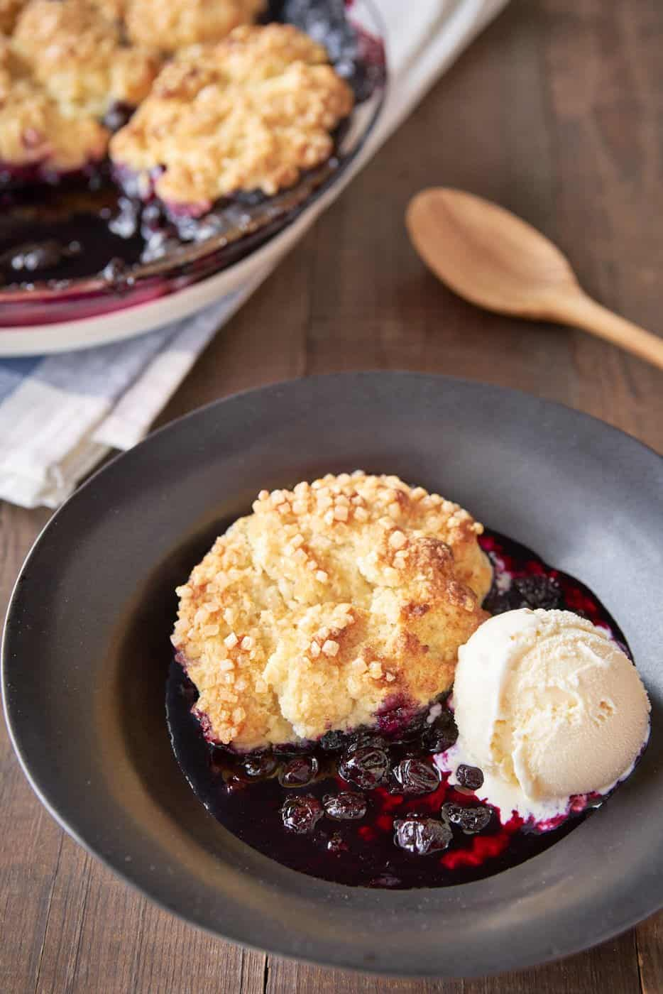 With a sweet and tangy blueberry filling topped with buttery sugared biscuits that are crisp on the outside and fluffy on the inside, this easy blueberry cobbler recipe is amazing.