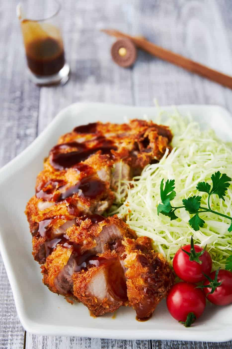 With thick rib-chops coated in a shatteringly crisp layer of panko breadcrumbs, and served with a spiced fruit sauce, Tonkatsu is Japanese home cooking at it's best.