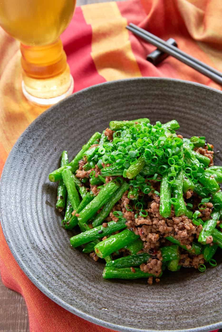 This easy Green Bean Stir Fry recipe is loaded with tender vibrant green beans and ground pork seasoned with a delicious chili garlic black bean sauce.