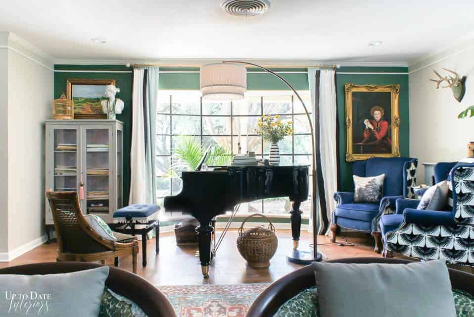 grand piano in front of large picture window with blues and greens eclectic glam maximalist style