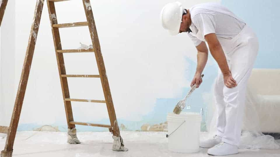 painter doing interior painting in winter