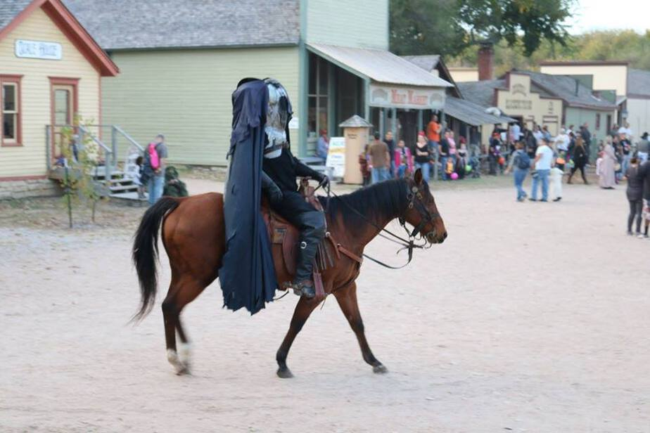 headless horseman rides the streets at hay hooves and halloween at cowtown museum in wichita