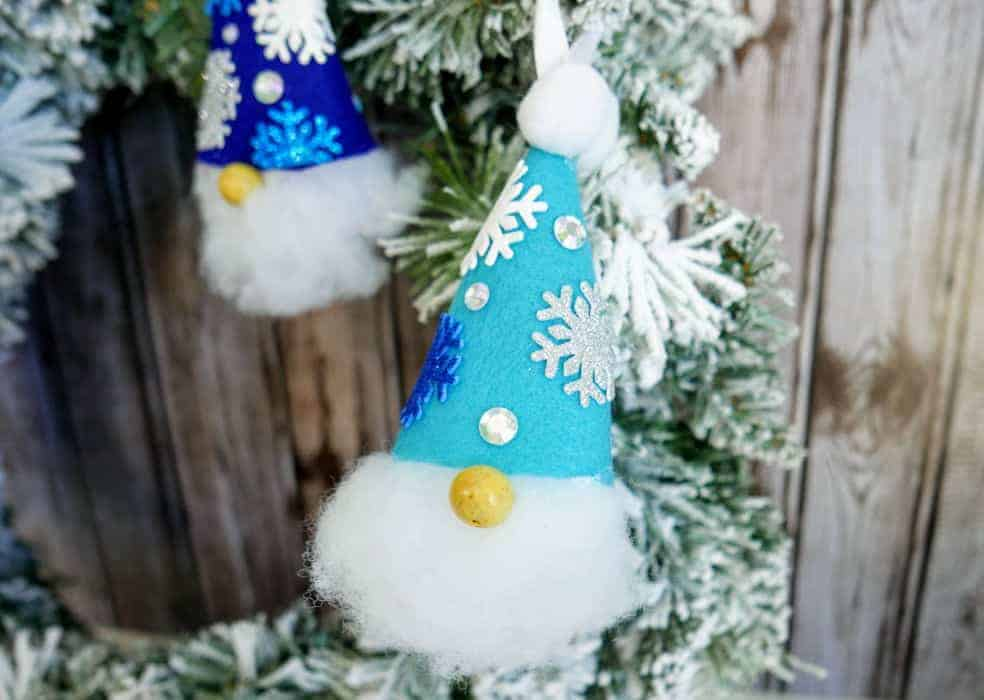 Christmas gnome ornament hanging from a wreath
