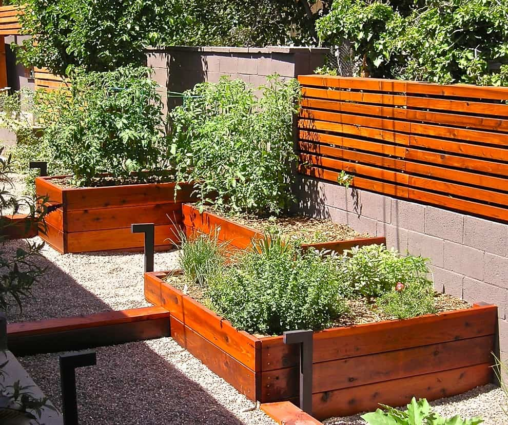 fencing from cinder block and wood with compatible planters