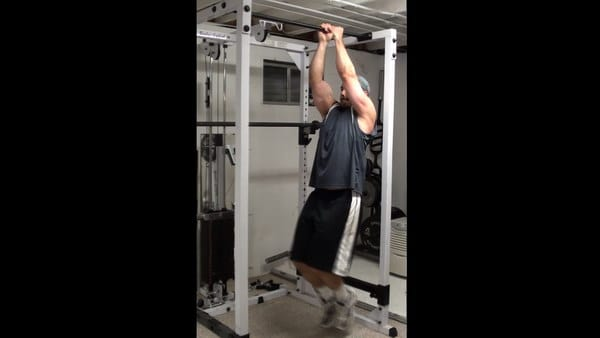 Perpendicular Bar Hanging Leg Raises for Targeted Oblique Training
