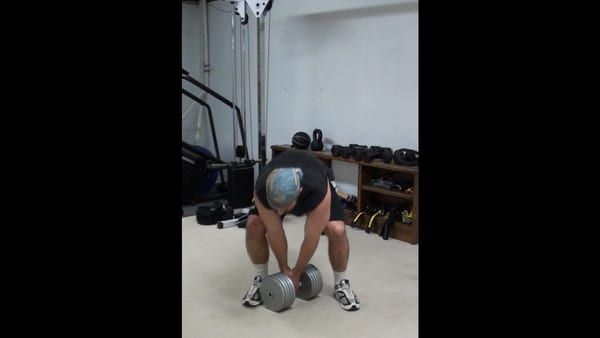 Resting Goblet Squats for Targeted Oblique and Leg Work