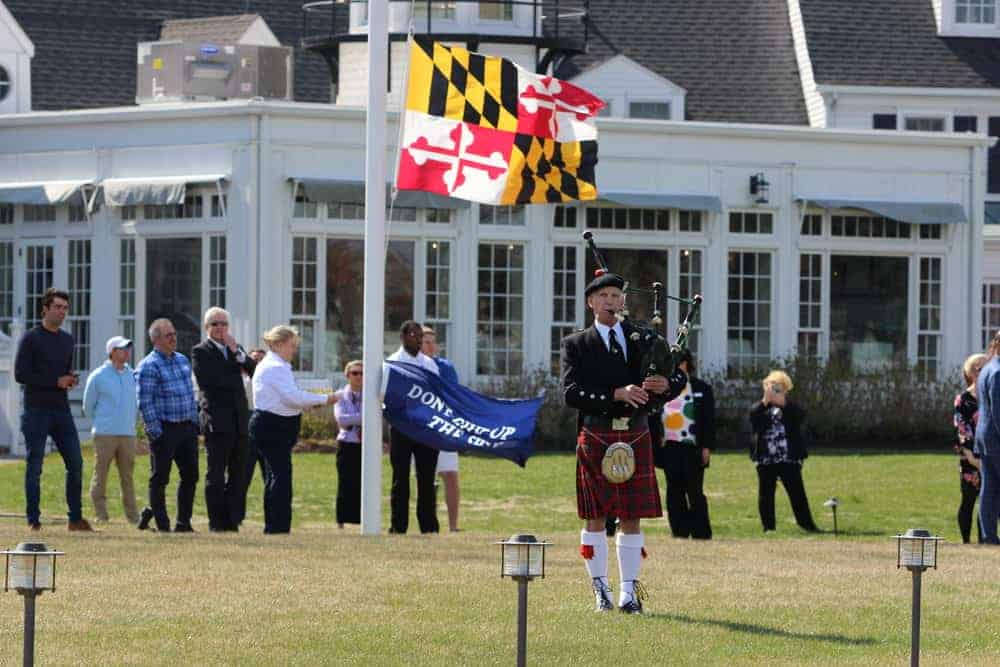 A bagpiper heralds the return of the fleet.
