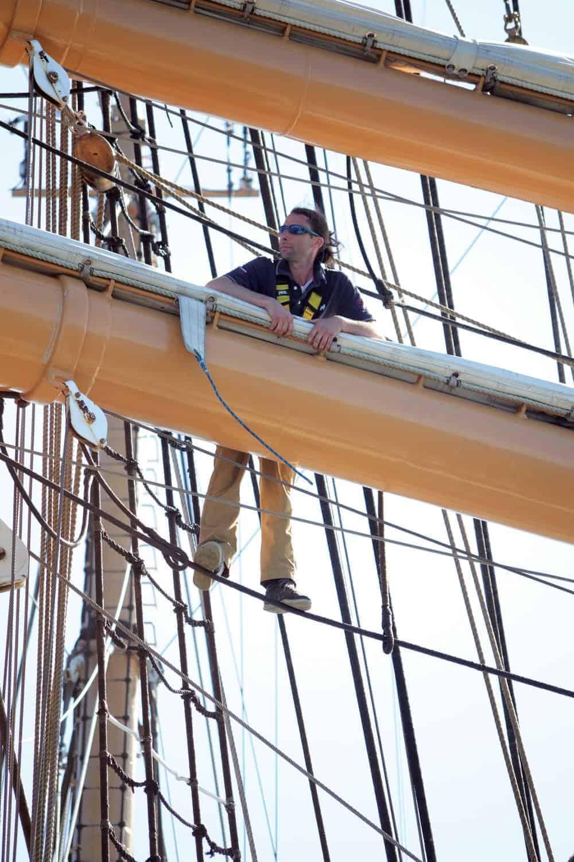 Sailmaker Justin Ailsworth aloft on the  Eagle .Photo by Karen Soule.
