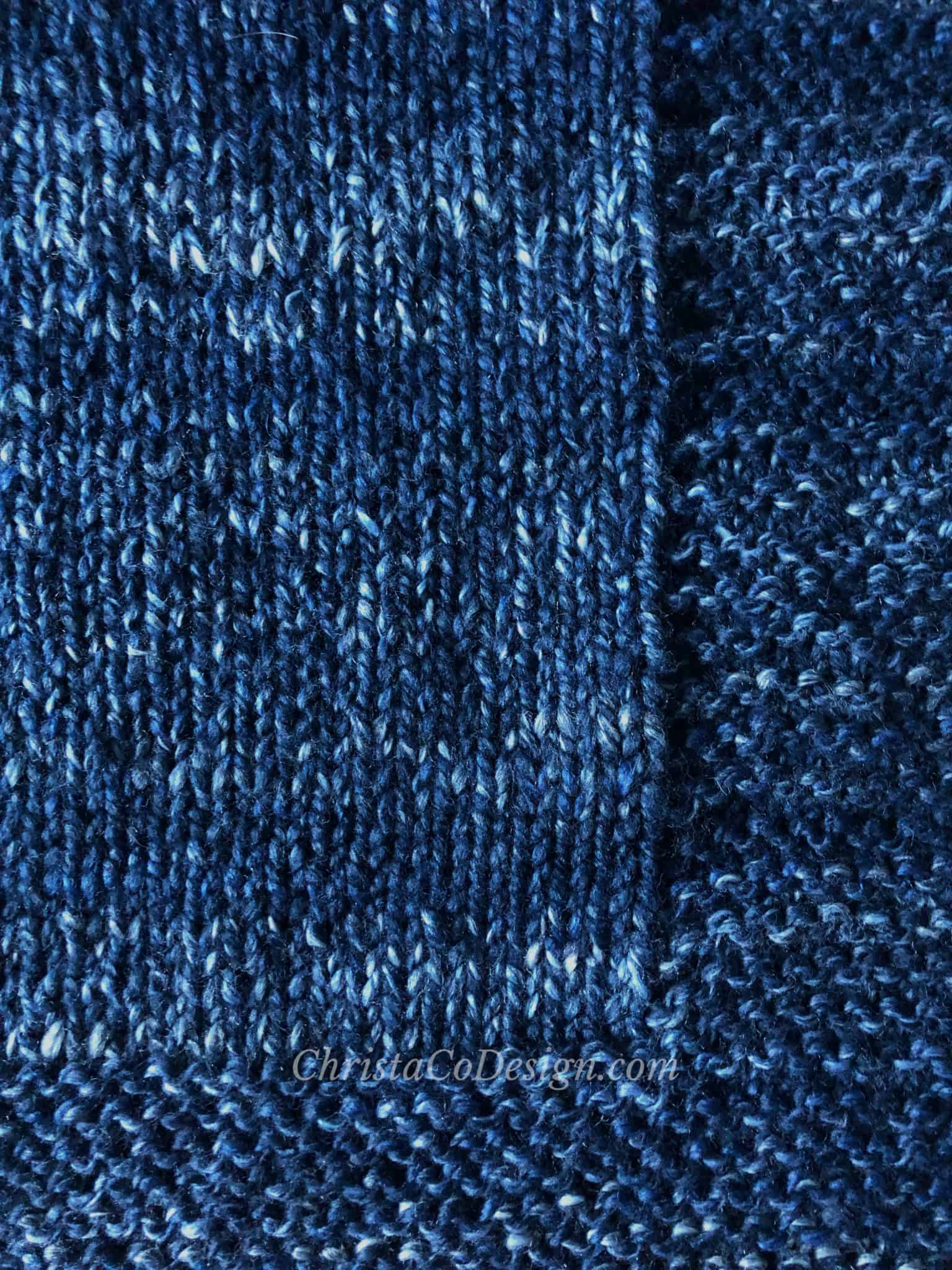 picture of blue chunky knit blanket easy garter stitch edge