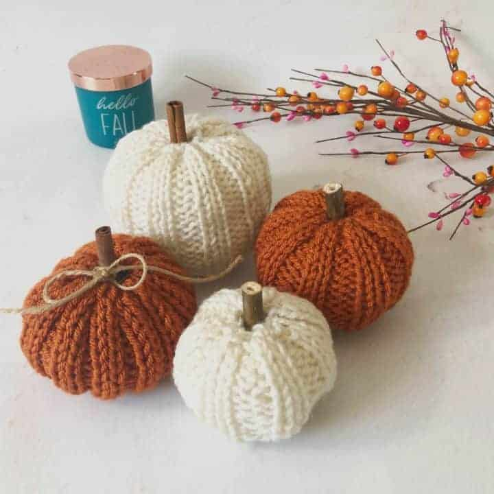 picture of fours small knit pumpkins in rust and cream