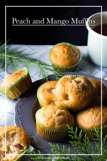 Peach and mango muffins on gray plate with greenery