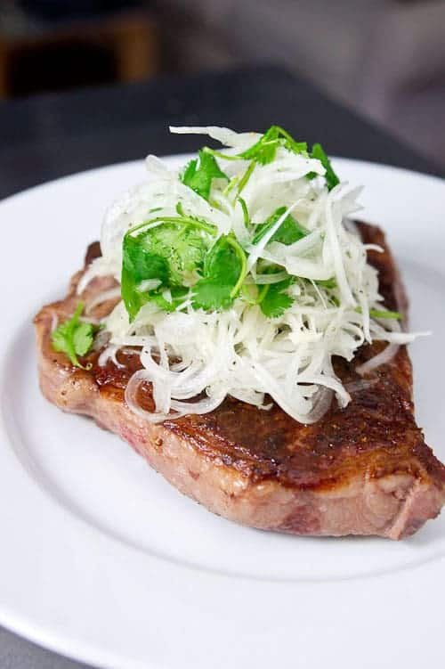 Sous Vide Porterhouse with Tamed Onion Salad