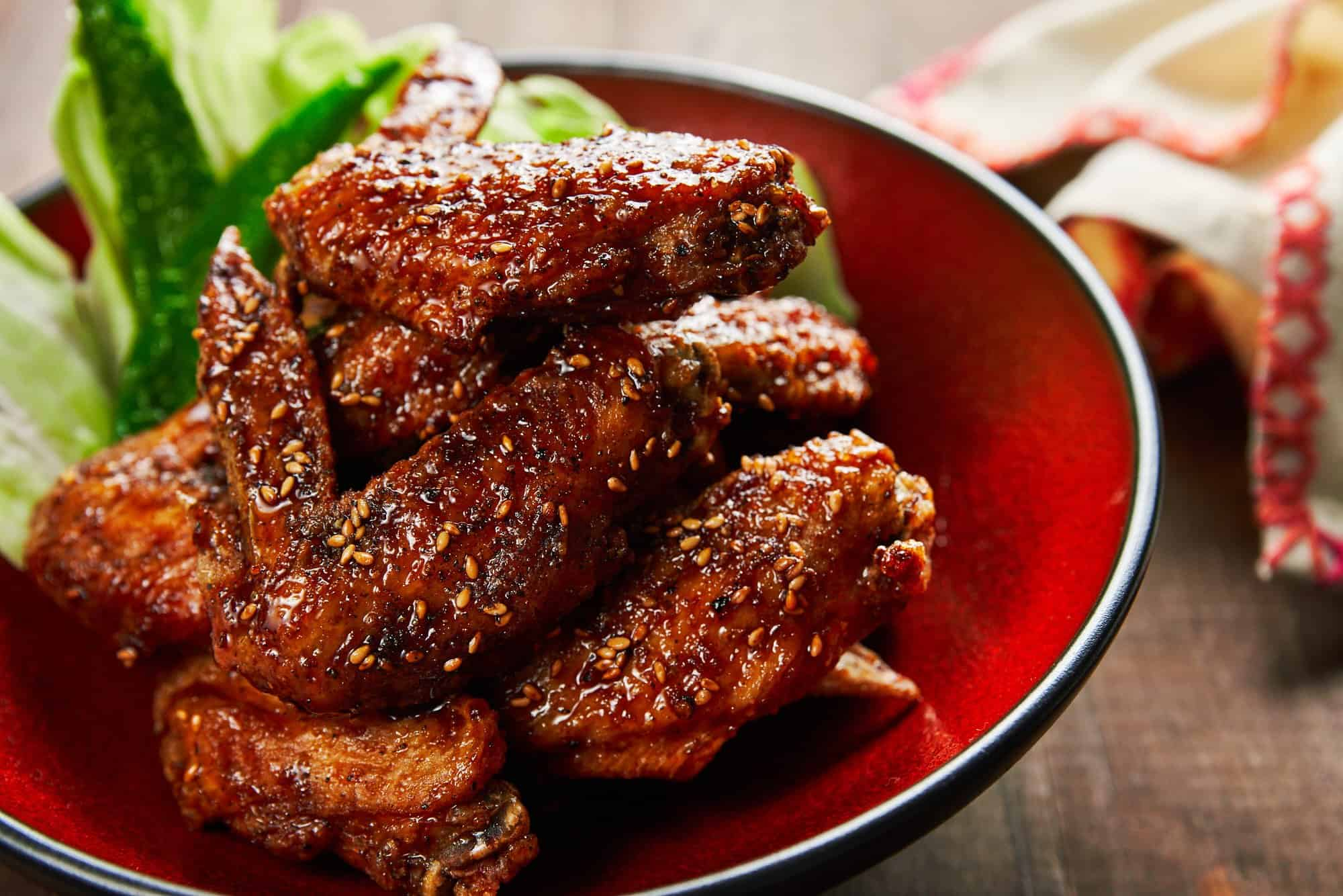 Ultra-crisp tebasaki chicken wings are the perfect game-day snack with their garlicky sweet and savory glaze that's loaded with black pepper.