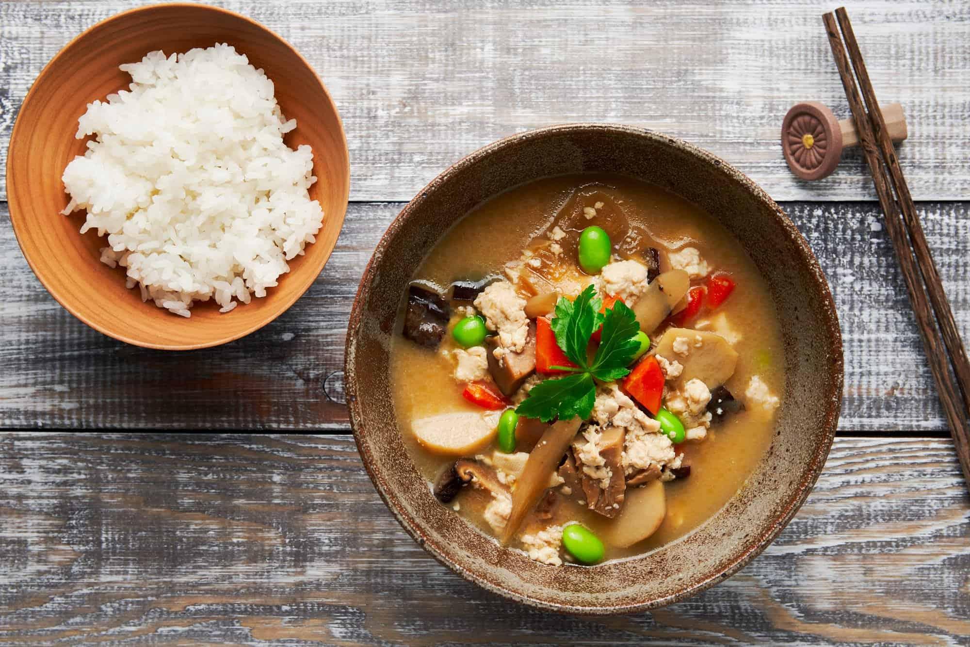 Kenchinjiru is a plant-based Japanese soup made with vegan dashi and loaded with carrots, tofu, edamame, shiitake, daikon and burdock.