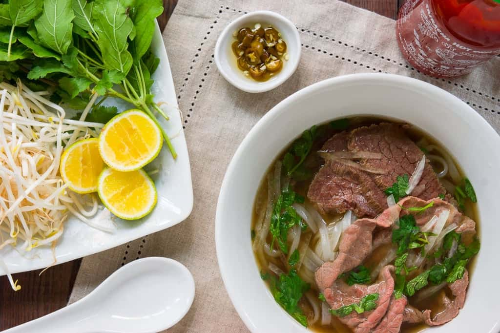 Recipe for making the best Pho. With tender brisket, rare steak in an fragrant oxtail broth.
