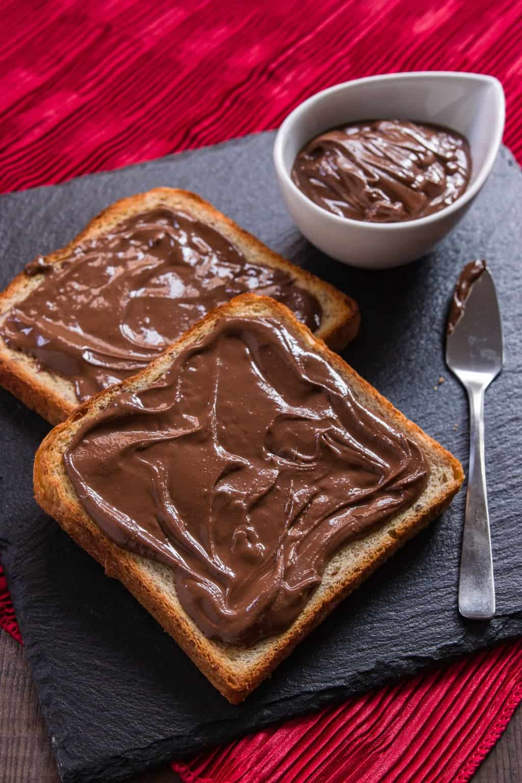 This chocolate sesame butter is smooth and creamy loaded with the rich nutty of sesame seeds for a decadent spread that goes with bread, pancakes, and french toast. Best of all, it only requires 4 ingredients and 5 minutes of your time to make.
