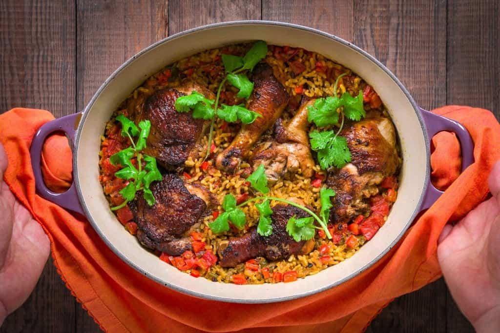 This Arroz con Pollo does take a bit of time to make, but for the extra effort you'll be rewarded with juicy marinated chicken atop a bed of incredibly flavorful rice.