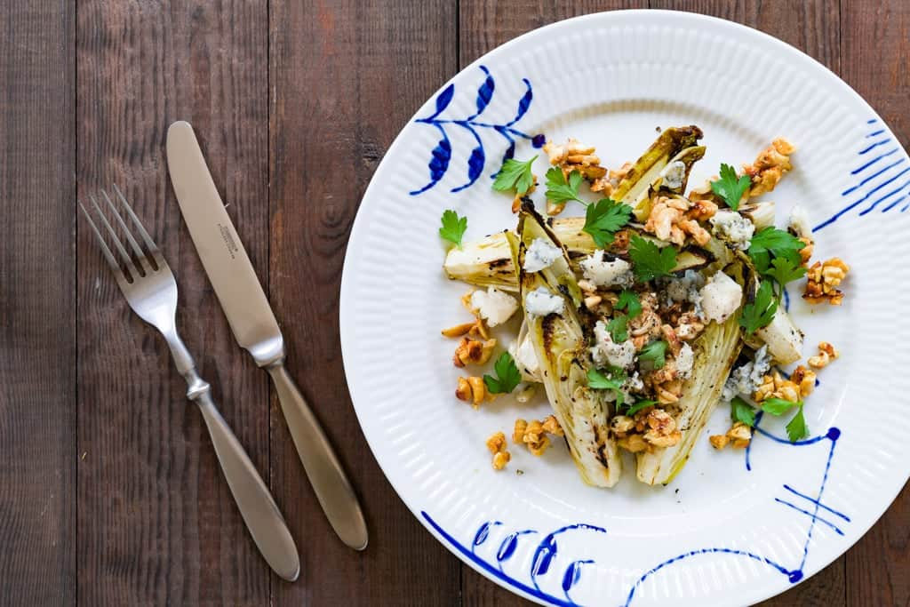 Marinated and grilled endive wedges with gorgonzola and honey roasted cashews.