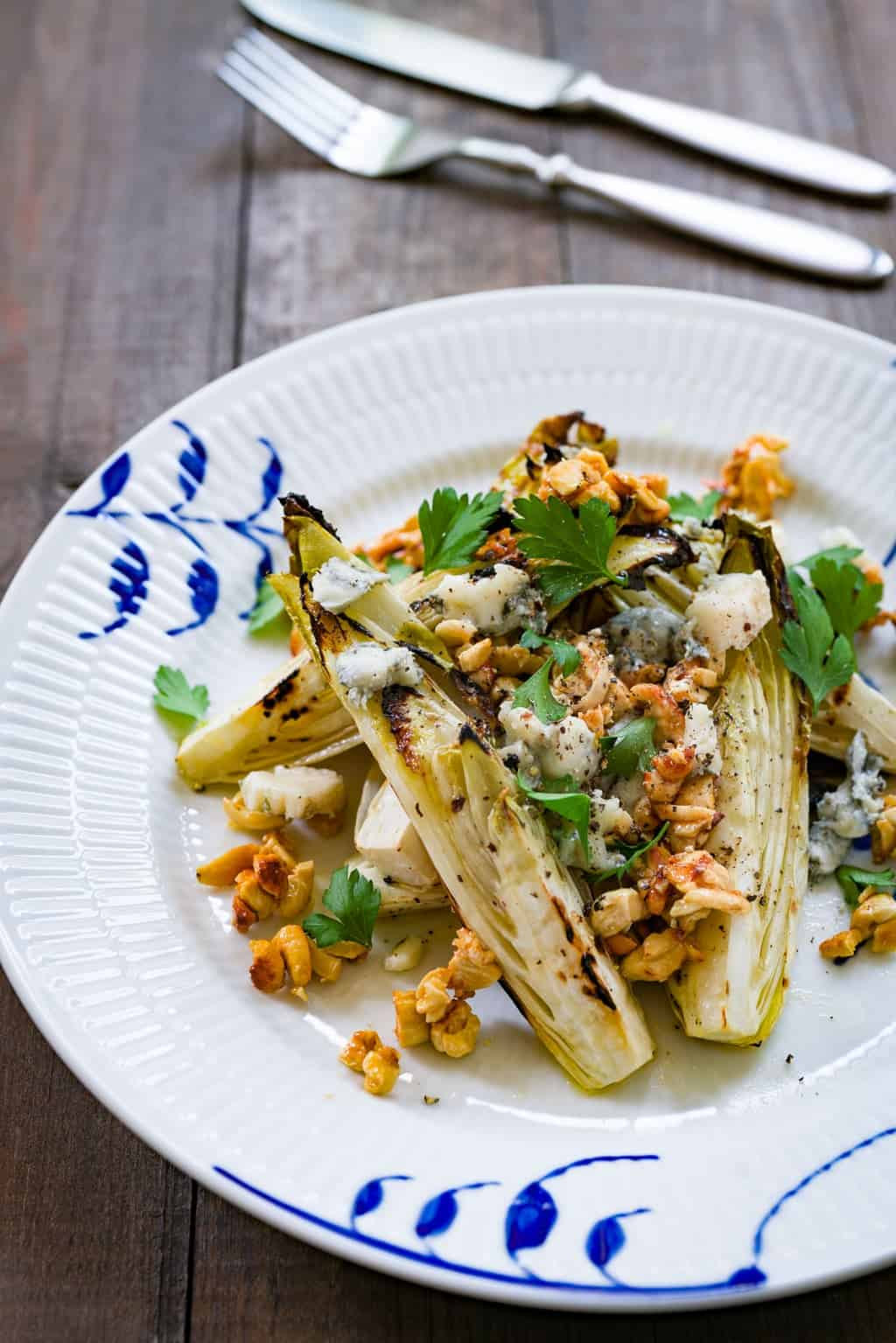 A delicious grilled endive salad with marinated char-grilled endives, honey roasted cashew nuts and gorgonzola cheese.
