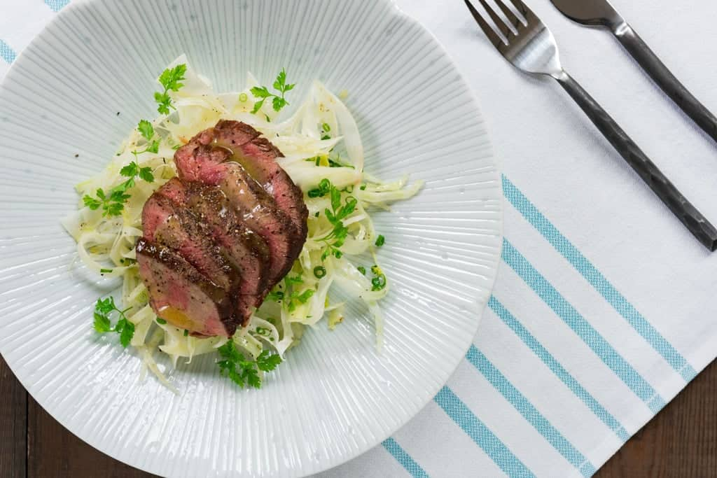 With savory tender slices of warm steak atop a bed of crisp shaved fennel and a fragrant yuzu dressing, ths salad makes for a delicious summer meal.