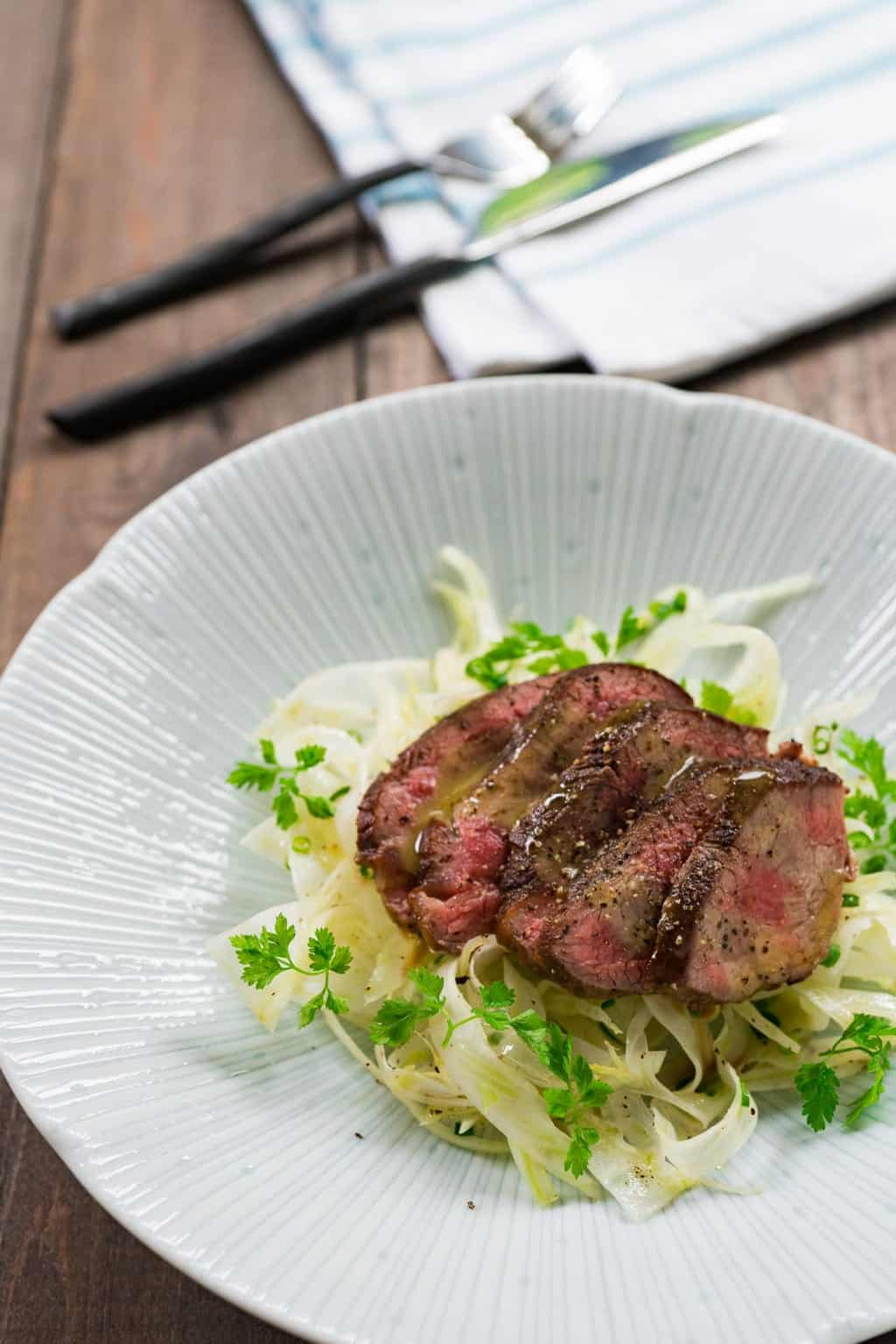 This shaved fennel salad with warm slices of seared fillet steak and a tangy yuzu dressing is a quick and delightfully delicious light summer meal.