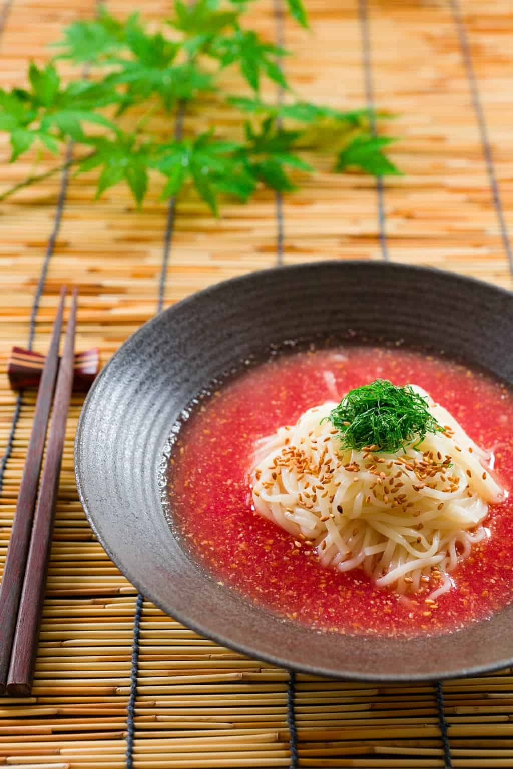 Chilled udon in an ice-cold tomato sesame broth. The perfect noodle soup for a hot summer day.