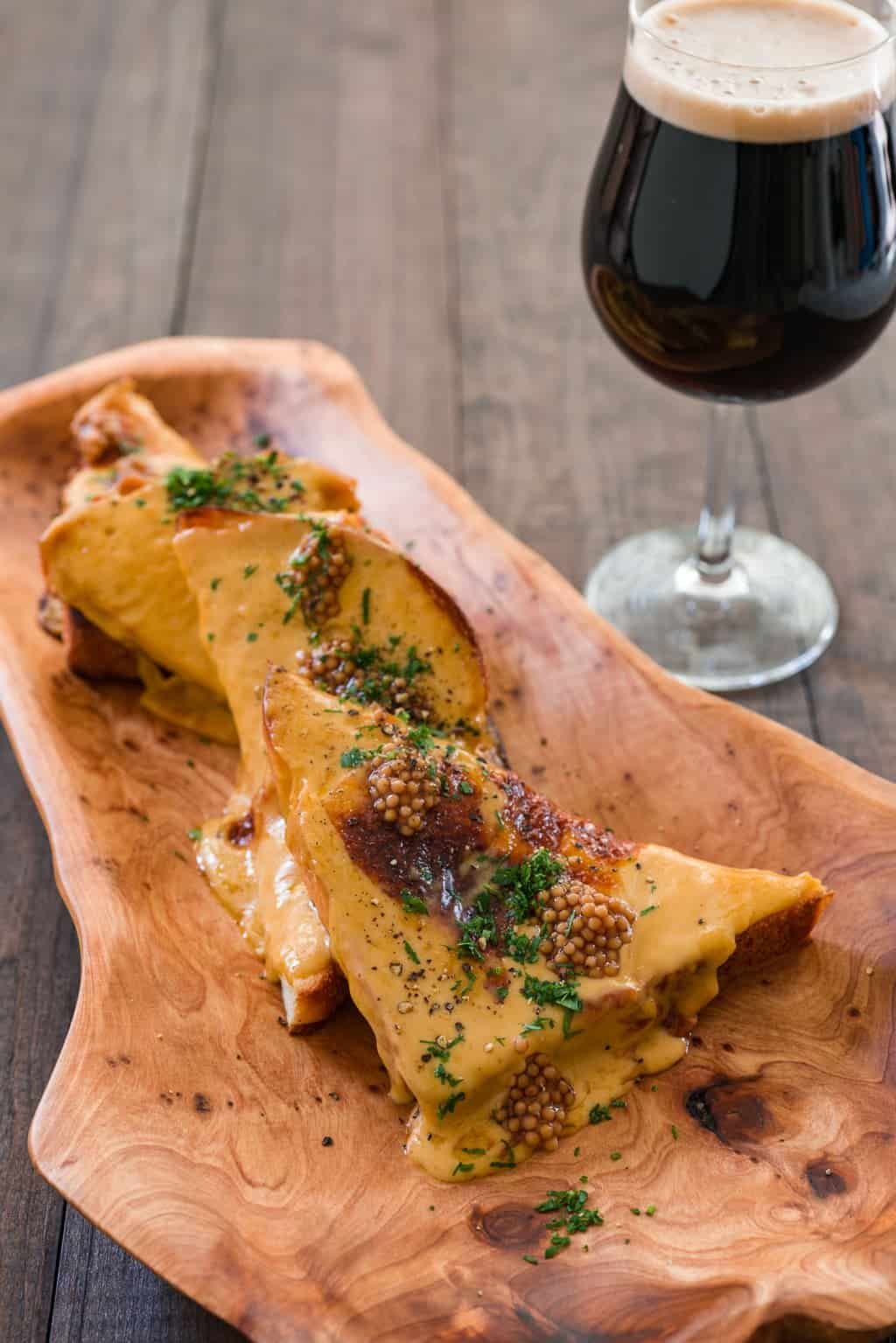 A delicious melty mess, Welsh Rabbit is an easy pub favorite with a stout infused cheese sauce browned on toasts (and no bunny rabbits).