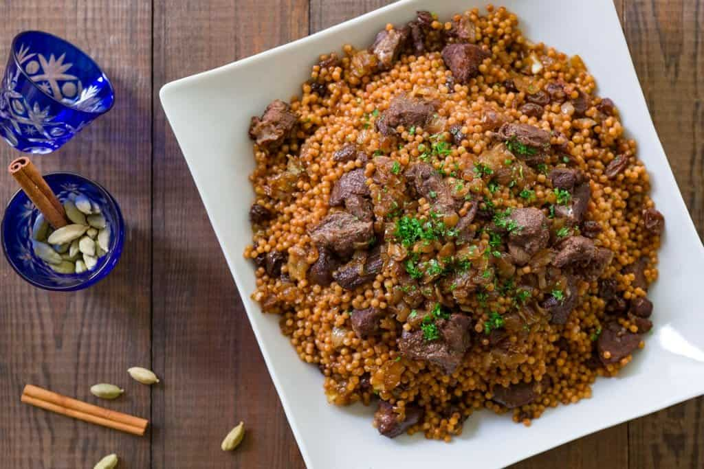 Israeli couscous cooked with lamb, caramelized onions and and raisins.