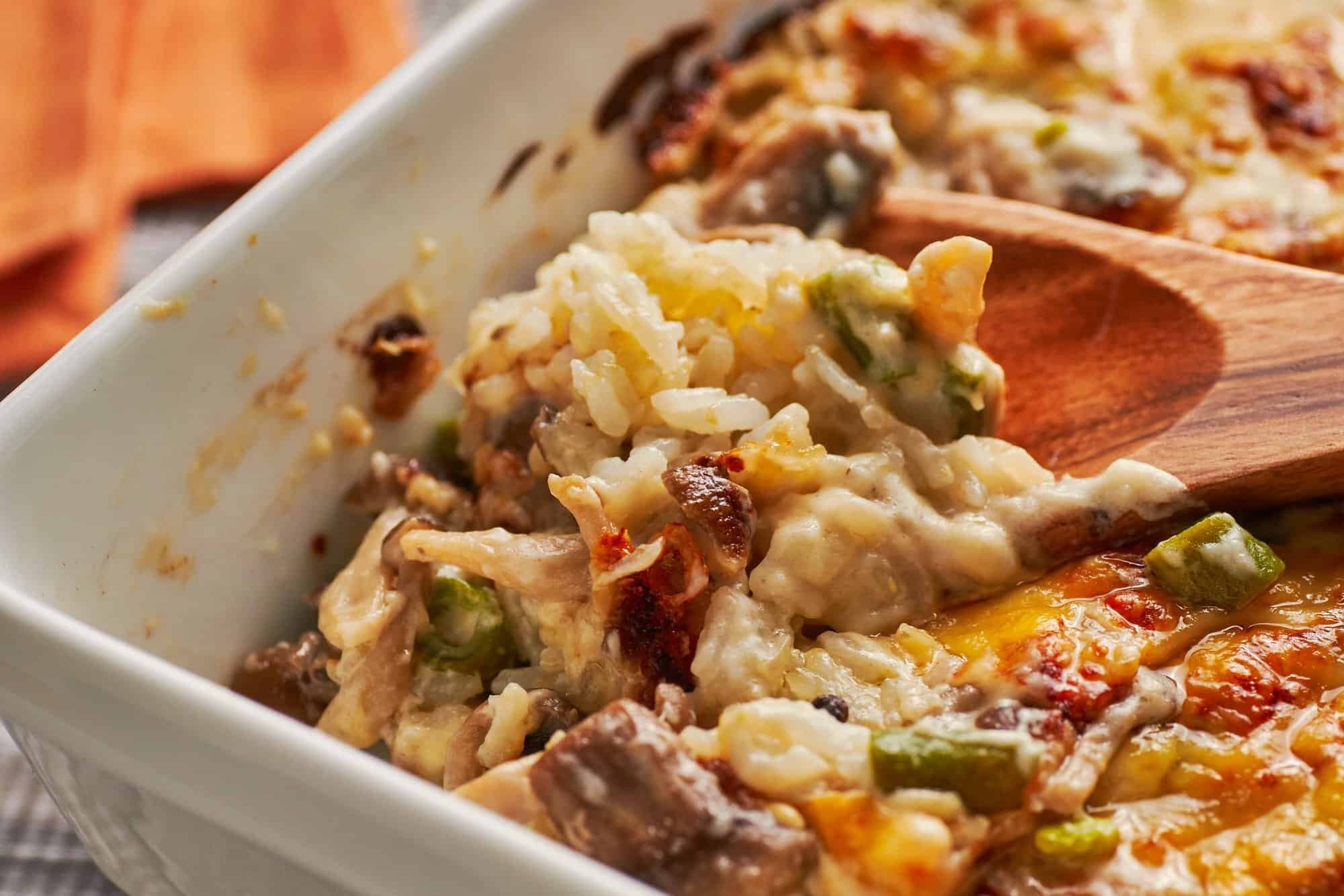 Under the bubbling sea of creamy mushroom and green bean bechmel and cheese lies a hearty bed of rice.