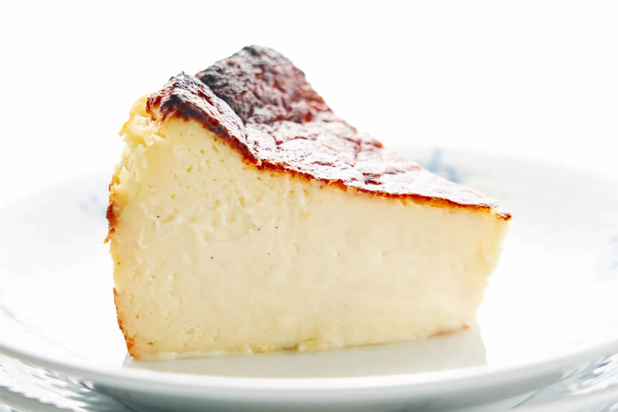 By baking the Basque Cheesecake in a scorching hot oven, the top gets a little burnt while the center remains silky smooth.