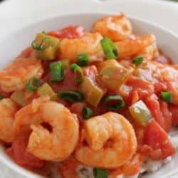 a white bowl filled with shrimp creole