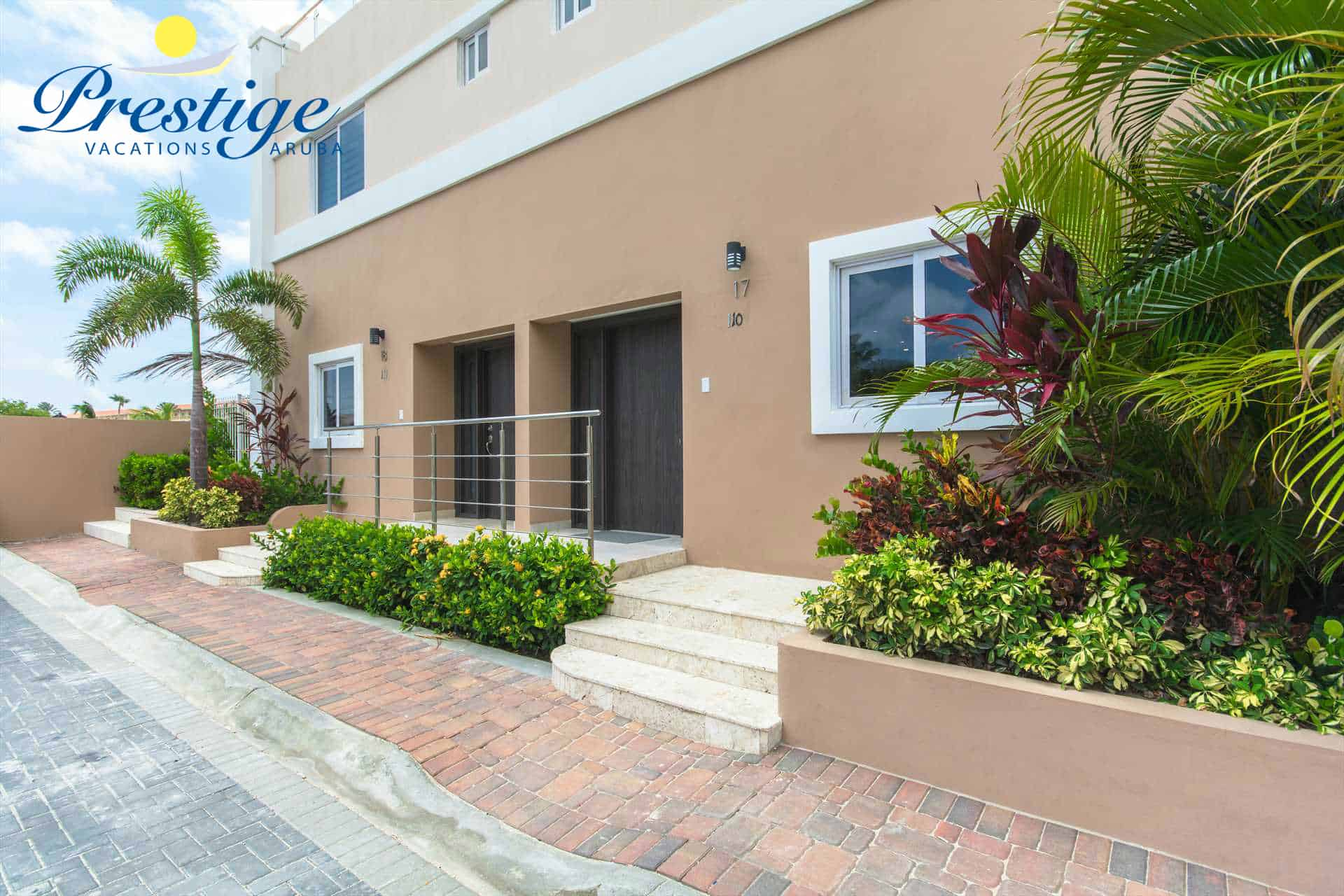 The entrance of your deluxe vacation rental beach home just steps from Eagle Beach
