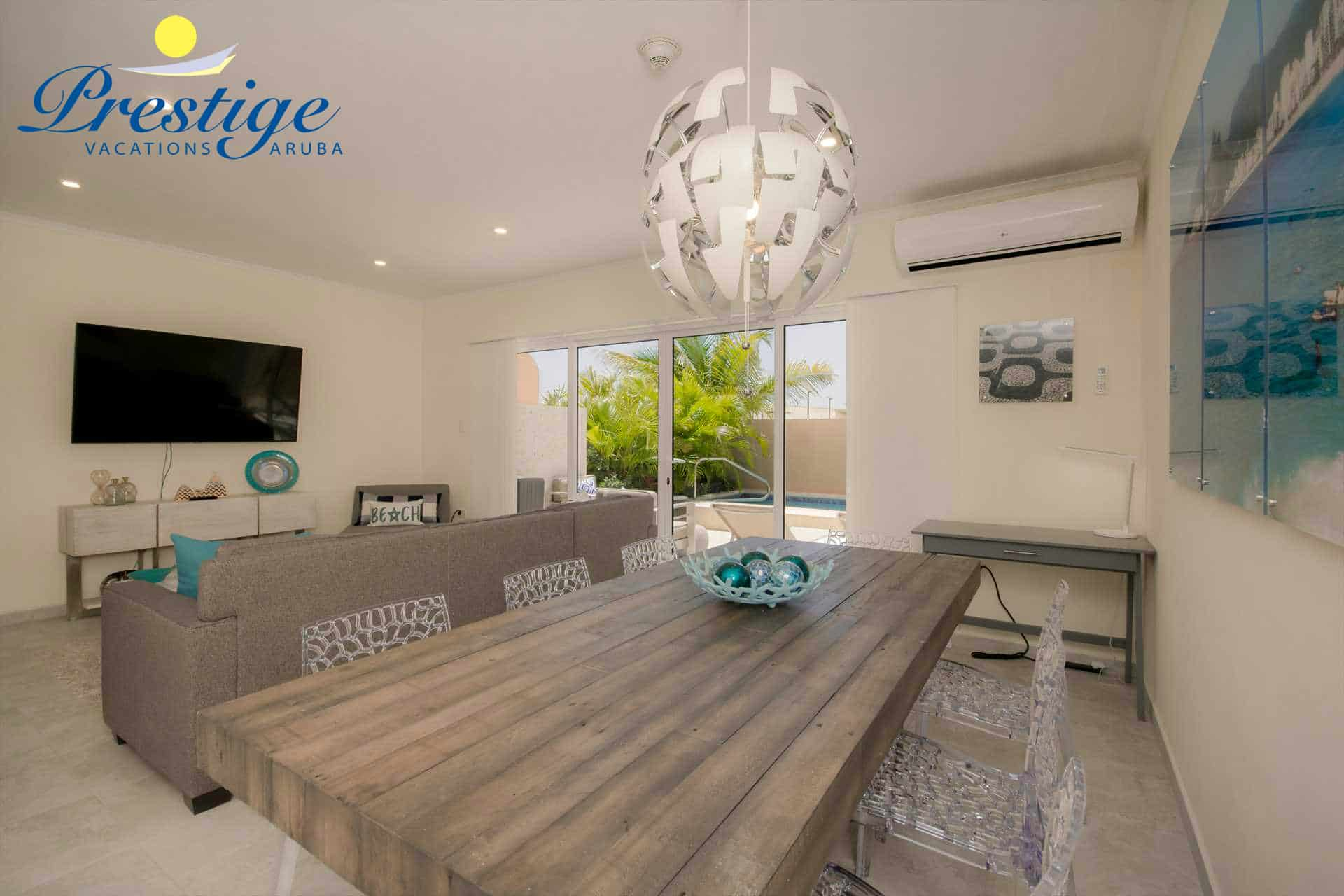 An 8-seat dining table in the living area with access to your private back patio with swimming pool