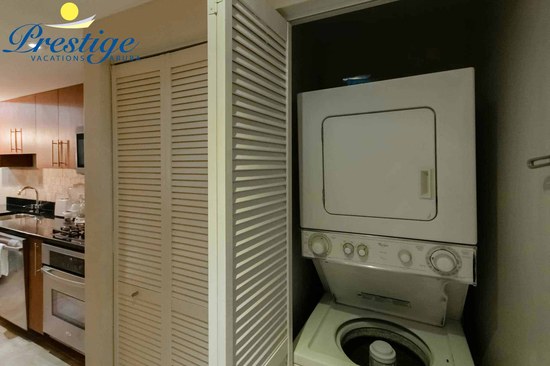 The in-room washer/dryer closet at the entrance of the studio condo