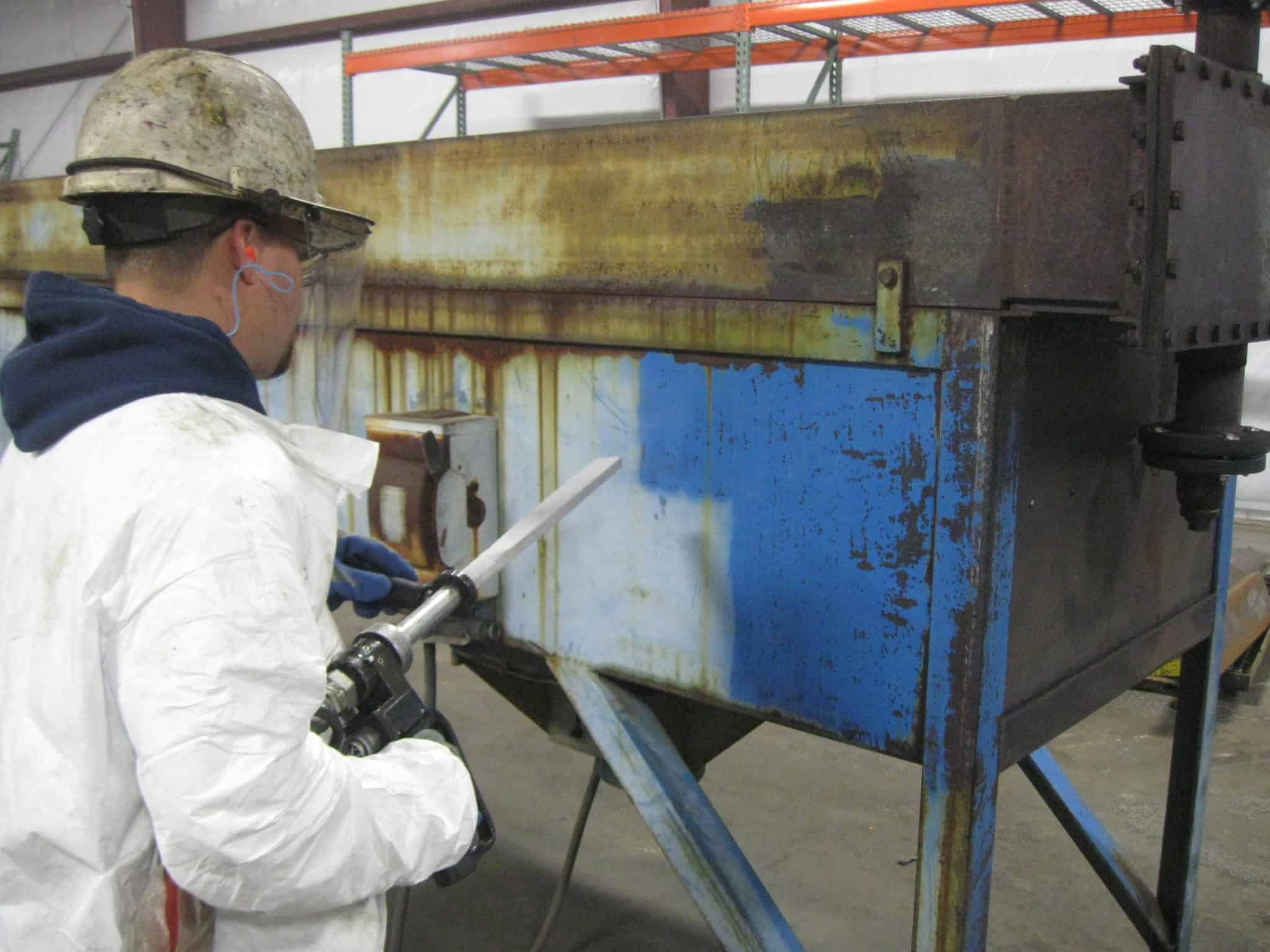 Dry ice blasting equipment prepping for repaint