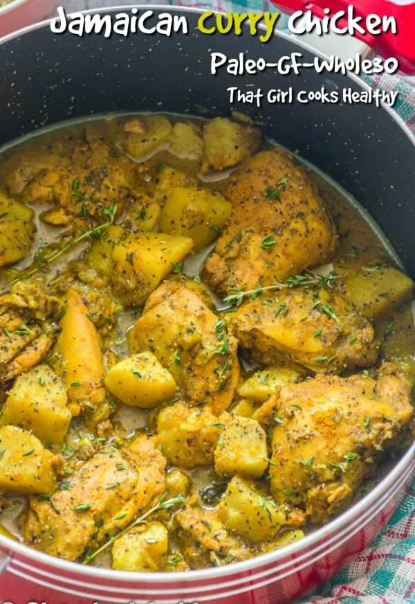 Jamaican curry chicken with potatoes in red pot